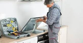 Man installing electric stove